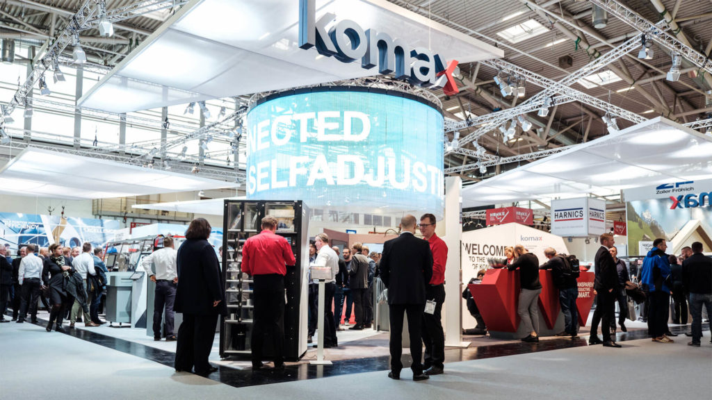 A3 News Messestand Komax AG Productronica 2020 Muenchen
